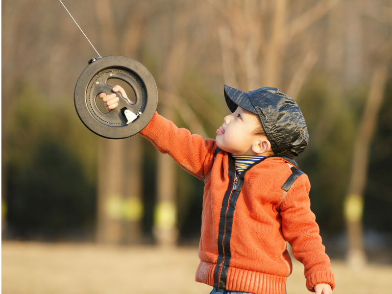 Child with winding handle