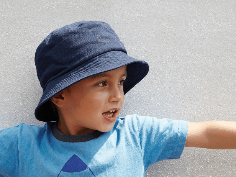 Child with bucket hat